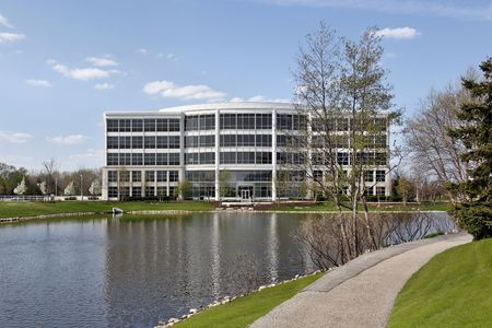 Office building in suburbs with lake and path photo