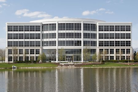 Office building in suburbs with lake in back photo
