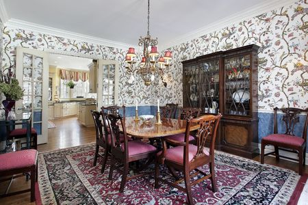 Dining room in luxury home with floral wallpaper photo