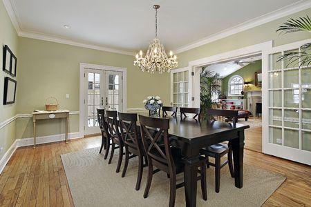 Dining room in luxury home with door to patio Stock Photo - 6846767