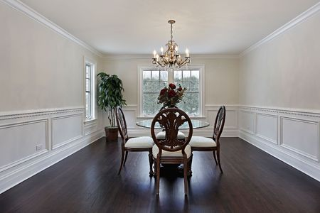 dining room: Dining room in luxury home with dark wood flooring Stock Photo
