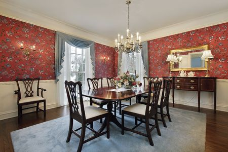 Dining room in luxury home with red floral wallpaper Stock Photo - 6846777