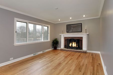 Family room in remodeled home with brick fireplace Stock Photo
