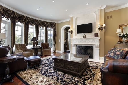 family  room: Family room in luxury home with fireplace