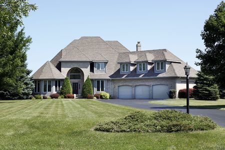 Luxury home with three car garage and cedar roof Stock Photo