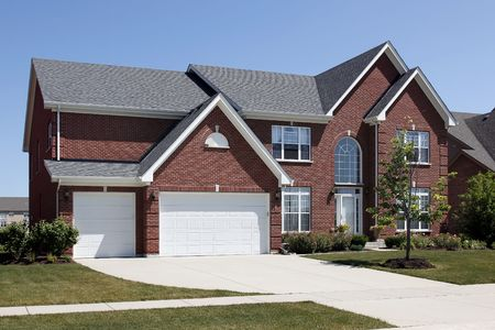 Red brick home in suburbs with three car garage Stock Photo - 6846795