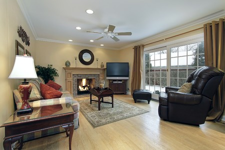 fireplace living room: Family room with fireplace and doors to patio Stock Photo