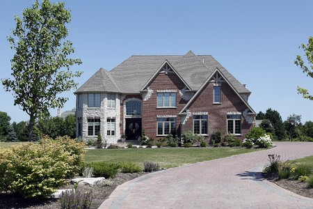 Brick home in suburbs with white stone turret Stock Photo