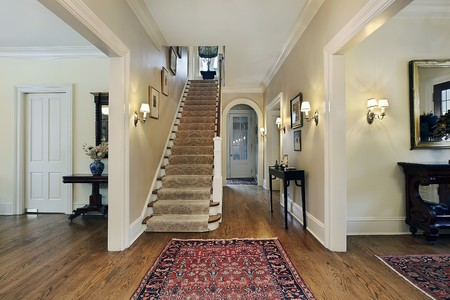 elegant staircase: Foyer in suburban home with dining and living room entry Stock Photo
