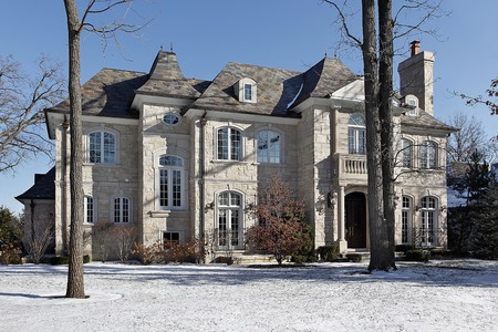 Luxury stone home in winter with front balcony Stock Photo