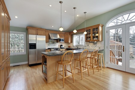 Kitchen in modern home with door to deck Stock Photo - 7773989