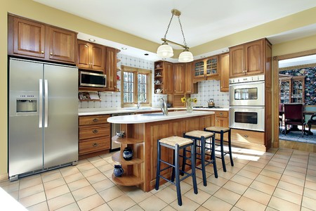 Kitchen in modern home with oak cabinetry photo