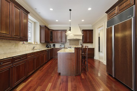 granite kitchen: Kitchen in luxury home with cherry wood cabinetry Stock Photo