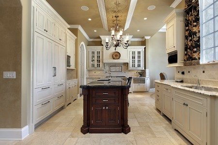 Kitchen in luxury home with marble island photo