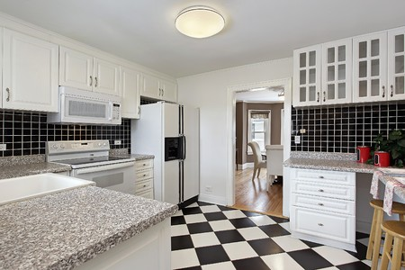 Kitchen in suburban home with checkerboard floor Stock Photo