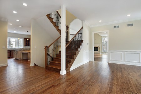 traditional living room: Foyer in new construction home with stairway