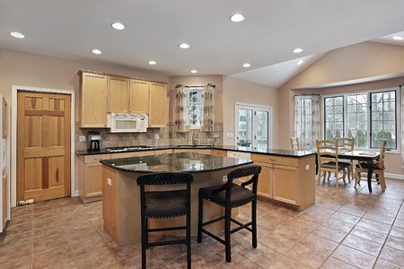 floor tiles: Luxury kitchen with eating area and center island