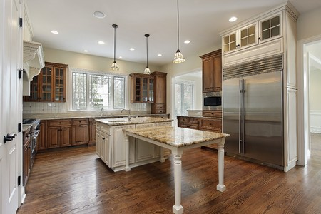 Kitchen in new construction home with wood cabinetry Stock Photo - 7750927