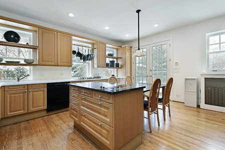 Kitchen in remodeled home with oak wood cabinetry Stock Photo