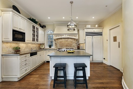Kitchen in luxury home with decorative oven backsplash photo