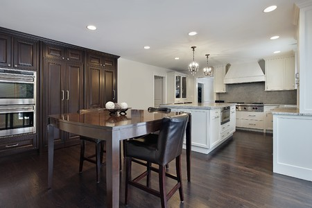 Kitchen in new construction home with dark wood cabinetry photo