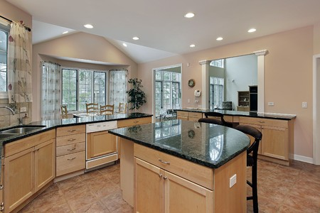 Kitchen in luxury home with marble top island photo