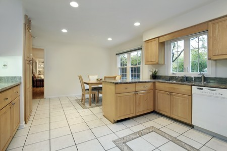 Kitchen with floor design and eating area photo