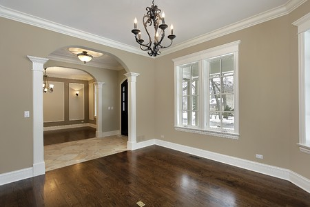 Living room in new construction home with foyer view photo
