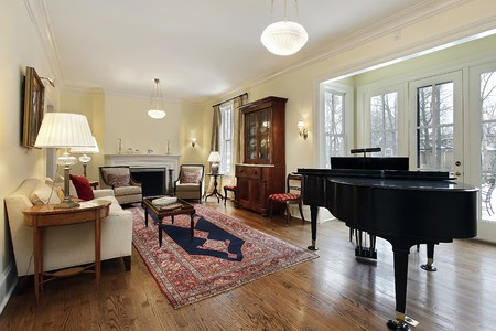 Living room in luxury home with large piano photo