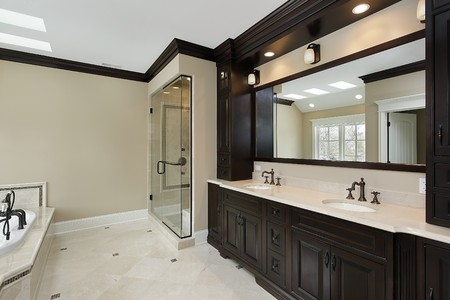 cabinetry: Master bath in new construction home with dark cabinetry