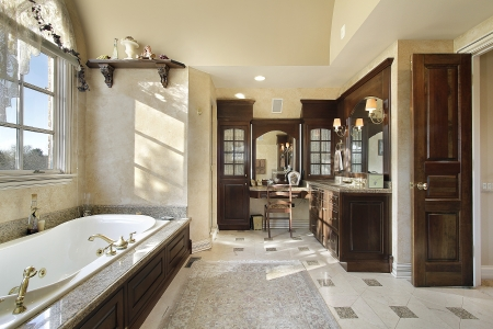 bathroom interior: Master bath in new construction home with dark cabinetry