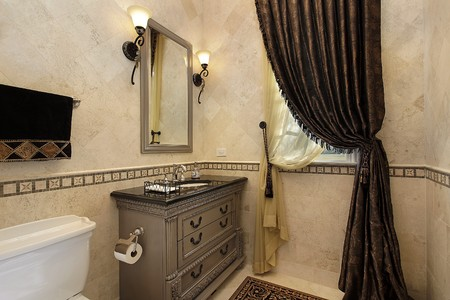 Powder room in luxury home with elegant draperies photo