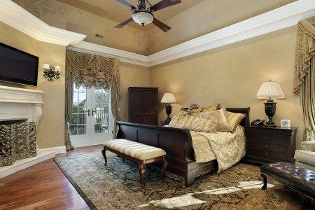 luxury bedroom: Master bedroom in elegant home with fireplace