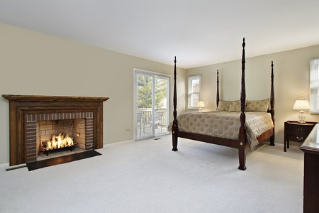 Master bedroom with brick and wood fireplace Stock Photo - 7750850