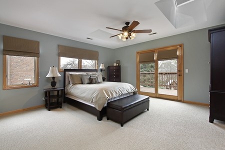 master bedroom: Master bedroom with doors leading to deck Stock Photo