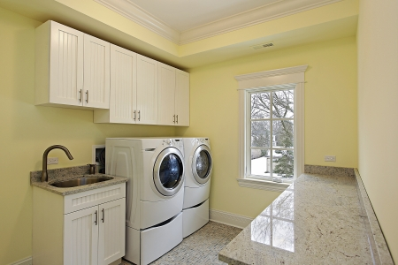 laundry room: Laundry room in luxury home with large washer and dryer