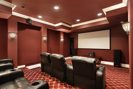 Theater room in luxury home with stadium seating photo