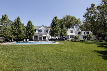Back yard of large white home with swimming pool Stock Photo - 7809851