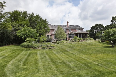 Luxury brick home with large back yard Stock Photo - 7809848