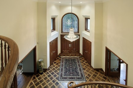 Foyer of luxury home with oval glass window photo