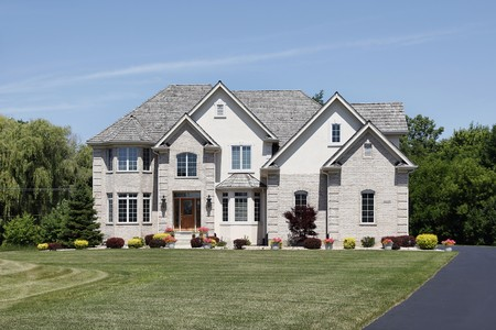 Large home in suburbs with cedar shake roof photo