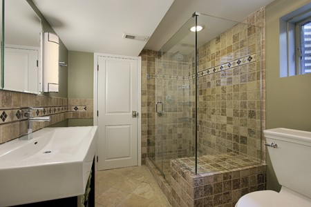 Bathroom in luxury home with glass shower  photo