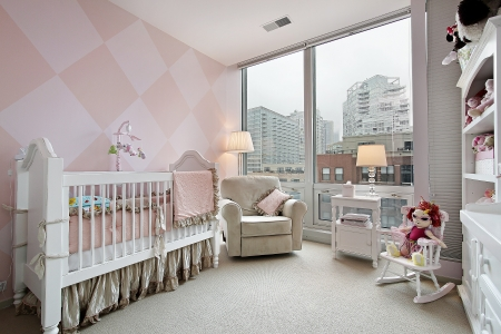 Babys room in condo with city view Stock Photo