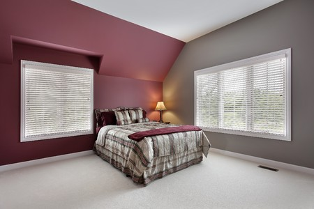 Large bedroom with maroon and gray walls Stock Photo - 7809807
