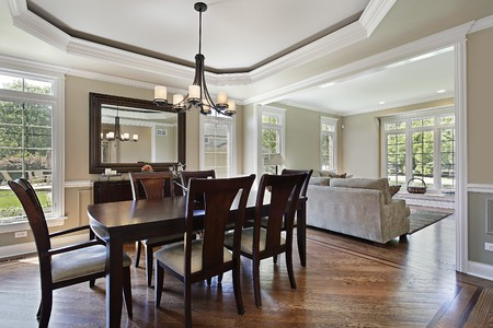 decor: Dining room in luxury home with view into living area
