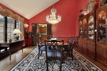 Dining room in suburban home with red walls Stock Photo - 10293106