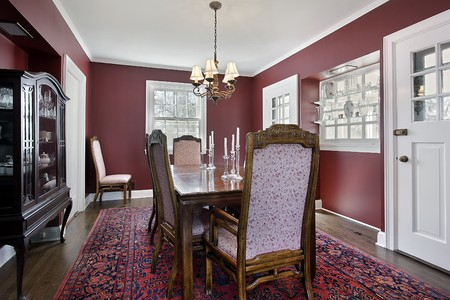 Dining room in suburban home with maroon walls photo