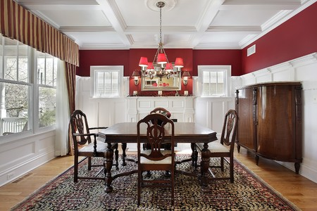 dining room: Dining room in luxury home with red walls Stock Photo