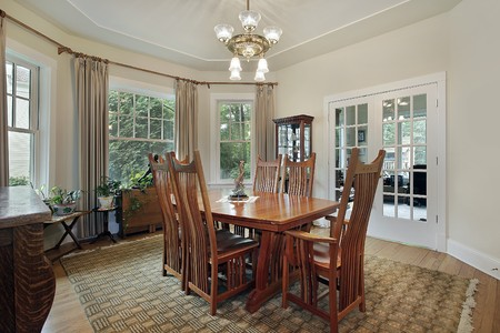 dining room: Dining room in suburban home with french doors