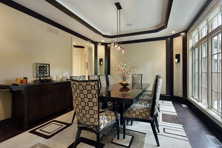 dining table and chairs: Dining room in luxury home with tray ceiling